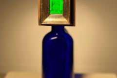 A Doghouse on a Blue Bottle